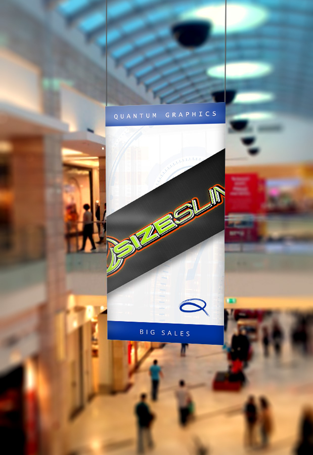 a banner hangs from the ceiling in a mall displaying size slim and big sales with quantum graphics written on the top
