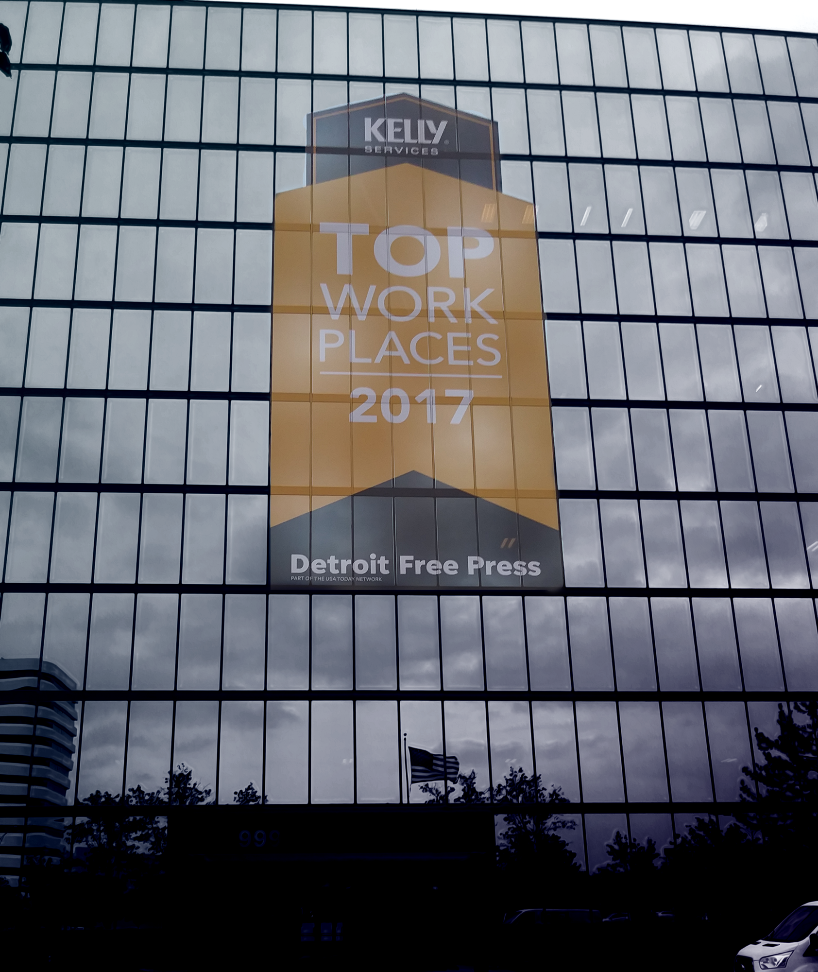 exterior of kelly services perforated window graphic 60' tall