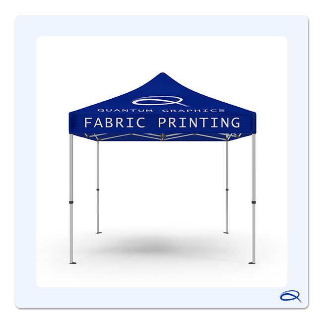 a tent stands alone with quantum graphics corporate q above the company logo and it also says fabric printing in large letters on the side