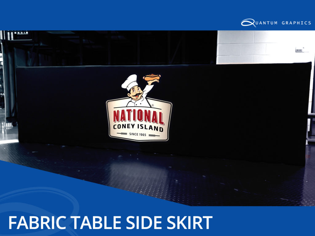 a fabric table runner side skirt with a fabric printed logo of national coney island on the side