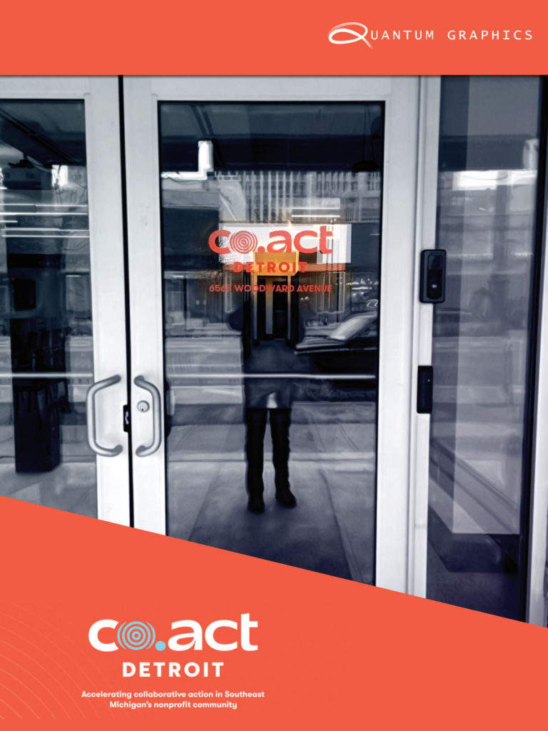 image of a vinyl window graphic of co.act detroit installed in front of woodward